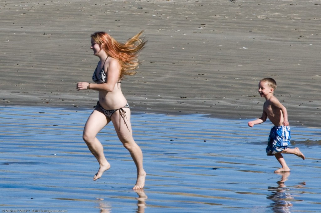 5 of 5 Mother with son playing in the water at Morro Bay beach